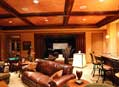 Entertainment and media room by Hughes-Edwards Builders
