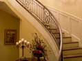 The curved staircase in a Nashville-area luxury home