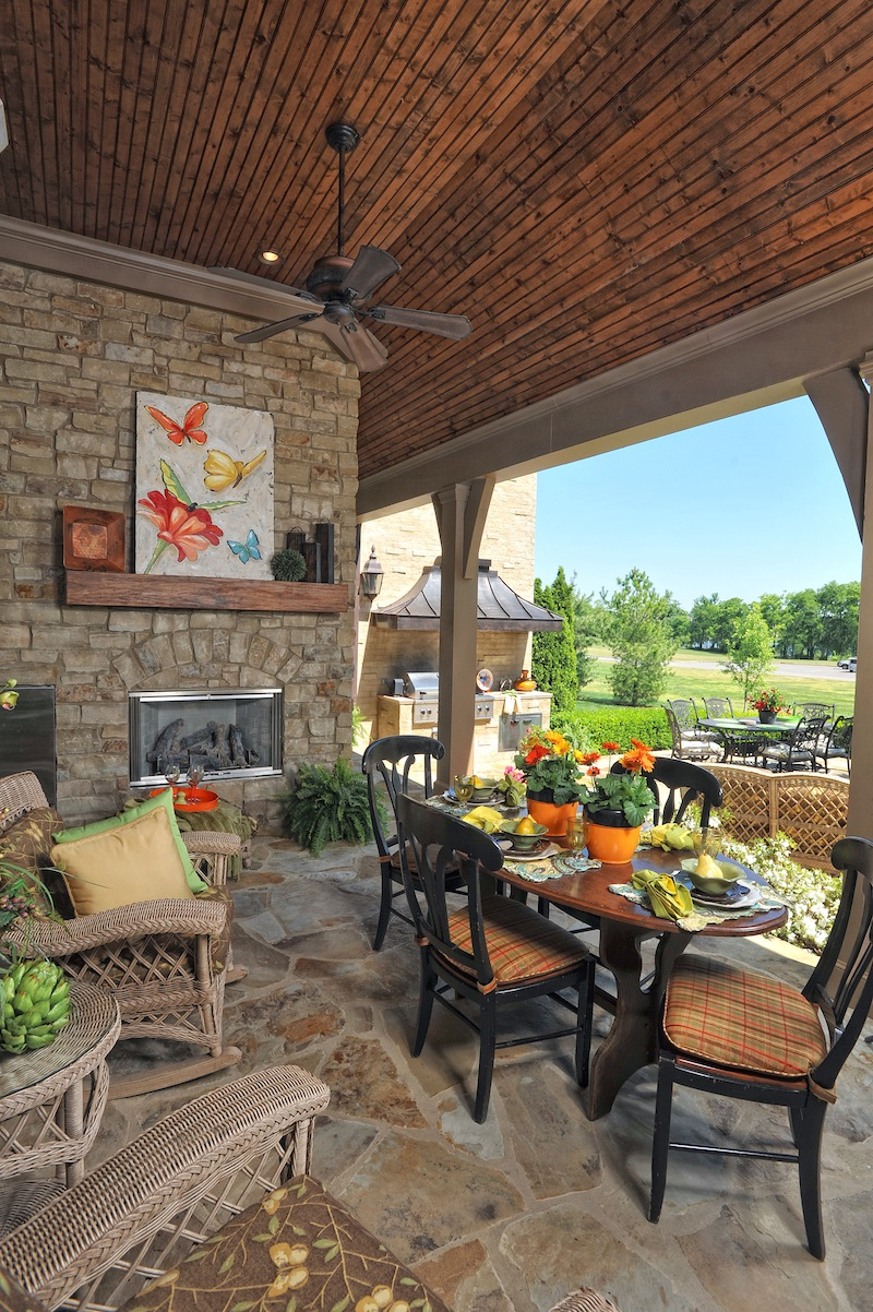 Outdoor living space with fireplace built by Hughes-Edwards Builders