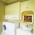 Spacious utility room with a washer, dryer, sink and storage space in a luxury home