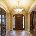 Custom foyer design with an elegant, wide door