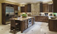 Custom luxury kitchen with brick and stainless steel appliances