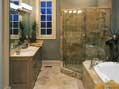 Posh master bathroom featuring a large tub and a separate walk-in shower