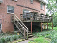 Before picture of a deck that Hughes-Edwards transformed into a screened porch