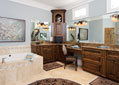 Elegant master bath with an oversized tub, ample seating and a powder room area
