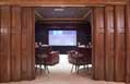 Open doors of a Hughes-Edwards custom media room in a Tennessee luxury home