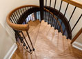 The elegantly designed custom staircase in a Hughes-Edwards home