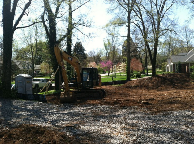 Moving dirt and preparing the site by Hughes-Edwards Builders